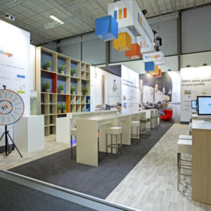 trivago booth at ITB Berlin has a wheel of fortune, and tables with computers
