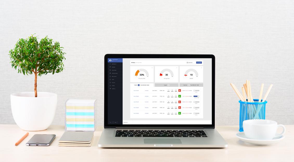 Base7booking cloud-PMS dashboard on a desk