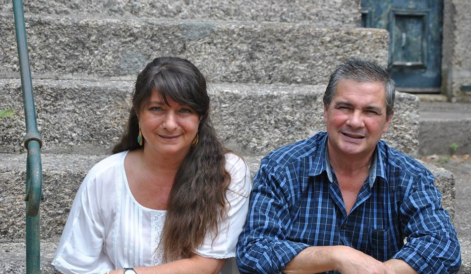 hotel owners Jose Maria and Ines sit on the fron steps of their hotel, Casa Do Outeiro Tuias