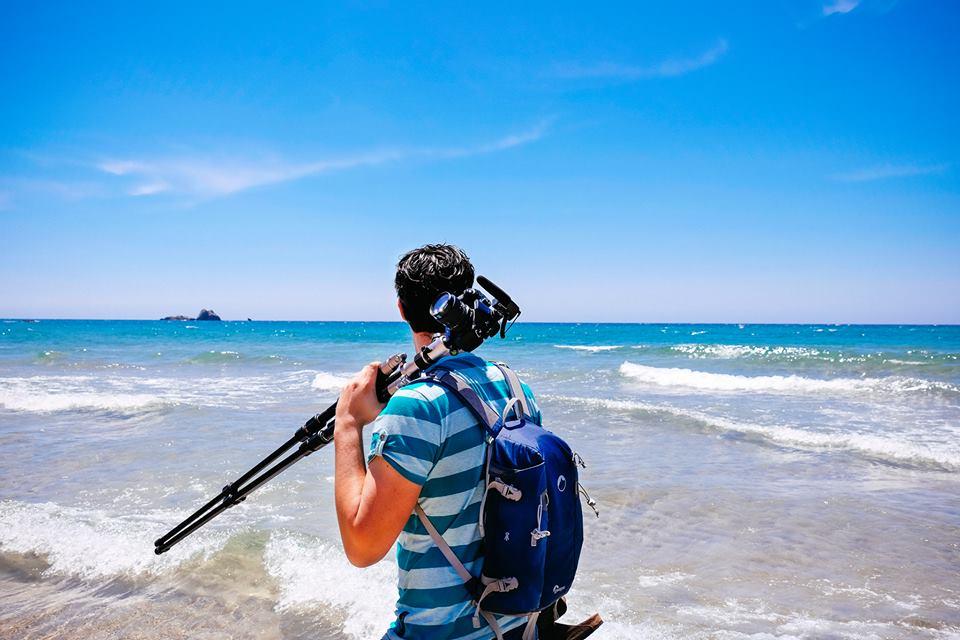Photographer Mateusz Chojnacki with his camera gear