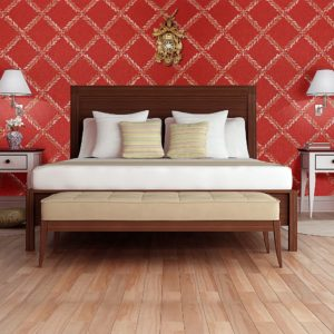 hotel room with red wall and golden clock