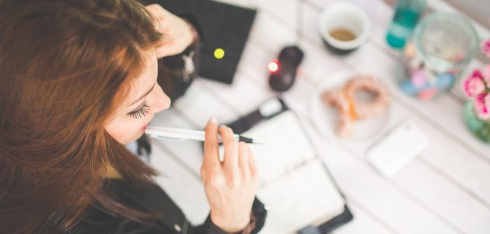 a woman works in her office on improving SEO
