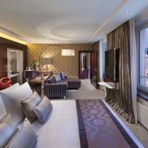 interior design hotel suite with purple and silver colour scheme