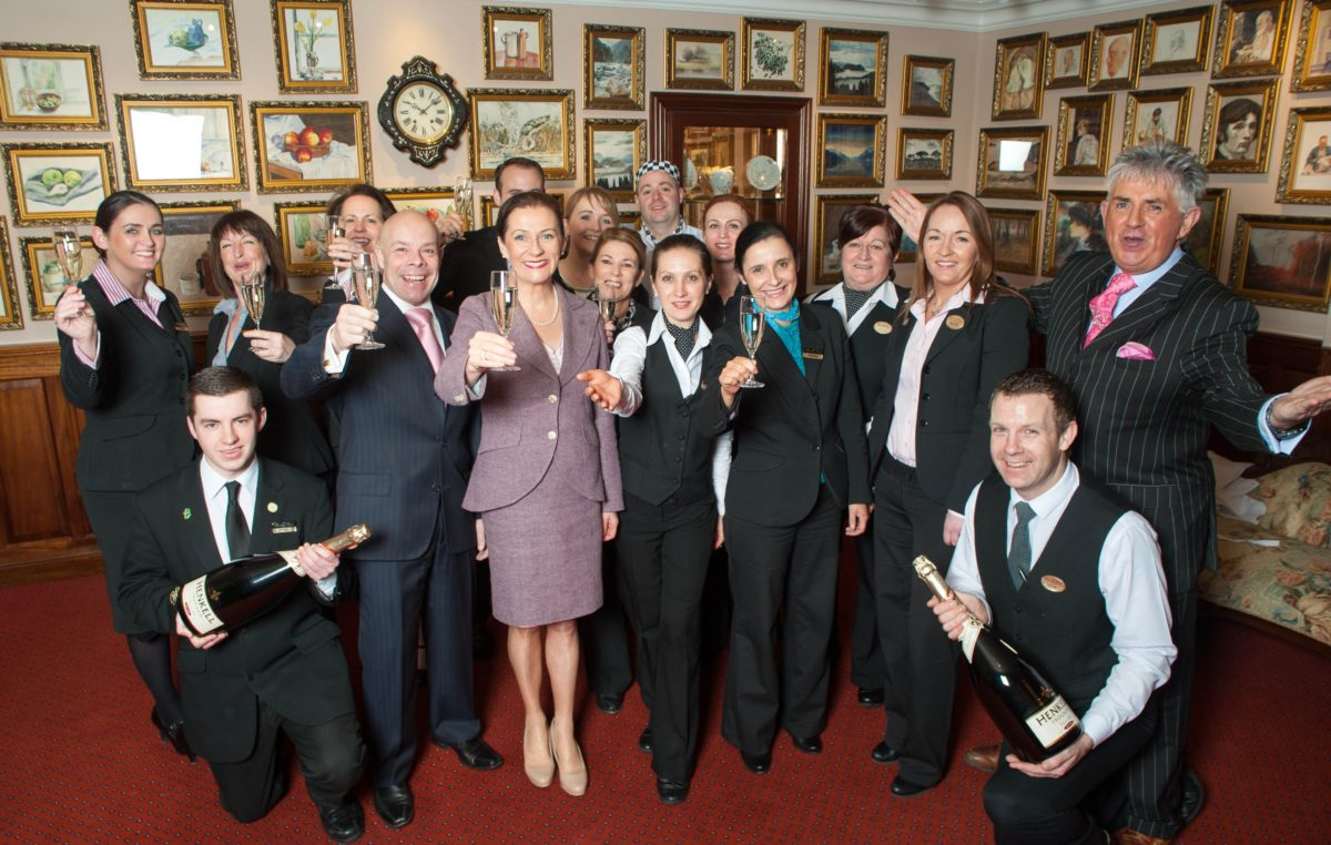 the staff at harvey's point celebrate their award with a toast