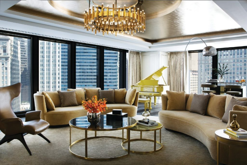 An elegant lounge with grand piano and bar at The Langham Chicago