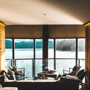 a hotel room overlooking a lake