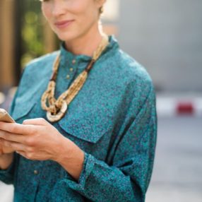 A hotelier looks up Rate Connect on her smartphone