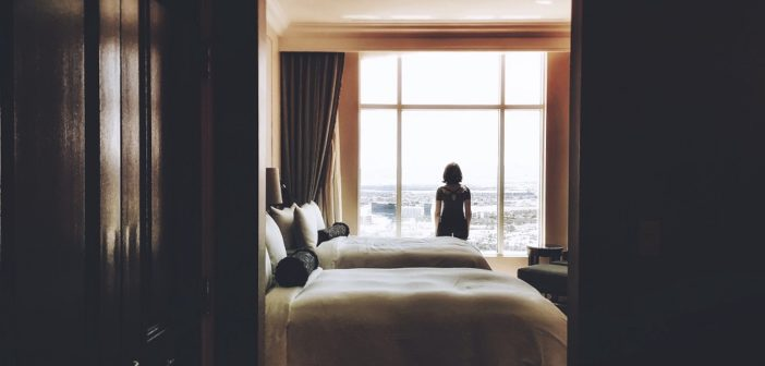 a guest looks out her hotel room window