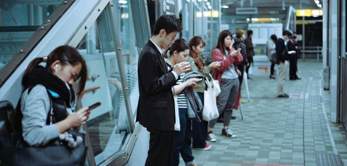 Commuters using mobile devices