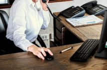 Independent hotelier on phone and desktop