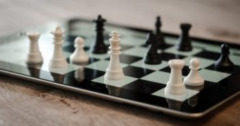 Chess pieces on a tablet