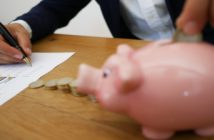A revenue manager with a piggy bank