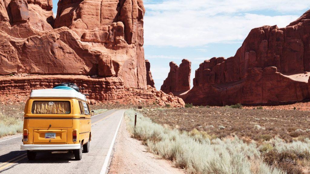 A yellow caravan in mountains